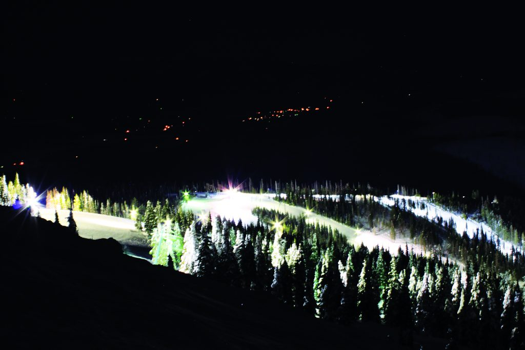 Photo of Mount Spokane all lit up at night from far away.