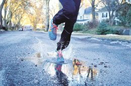 Stephen Barbieri finds a puddle on his morning run. Photo: Gabriella Meglasson