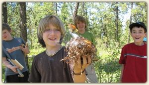 Fire and shelter building, ethics/Leave No Trace, and biking skills are just a few of the learning adventures that await your child. Photo: Twin Eagles Wilderness School