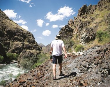 Hiking in Hells Canyon. Photo: Logan Crable, courtesy of ROW Adventures