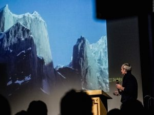 John Roskelley shares stories of expeditions that were most important to him to a packed theater of 700 people, including photographers and journalists from all over Europe. Photo: Piolets d'Or