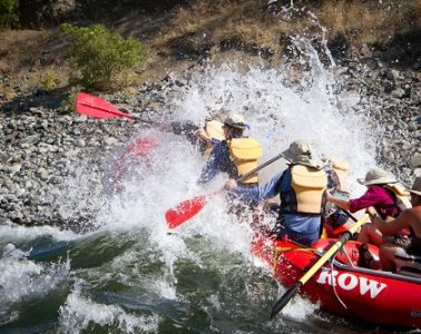 Rafters keeping warm paddling the Snake River. Photo: Jared Cruce, courtesy of ROW Adventures