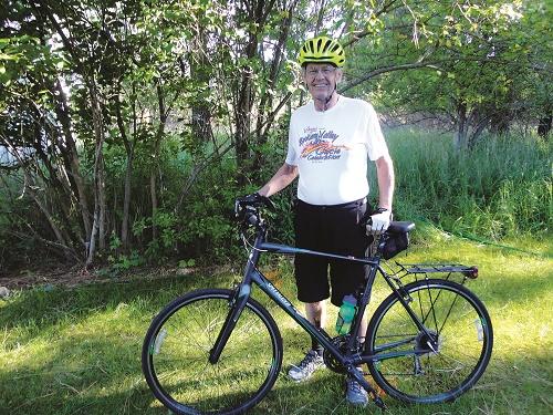Bill Gothmann, founder of Valleyfest's Cycle Celebration, stands by his bike. Photo: Carolbelle Branch