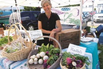 Tarawyn Waters of Urban Eden Farms in Vinegar Flats sells veggies at the Spokane Farmers' Market. Photo: Shallan Knowles
