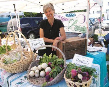 Tarawyn Waters of Urban Eden Farms in Vinegar Flats sells veggies at the Spokane Farmers' Market. Photo: Shallan Knowles