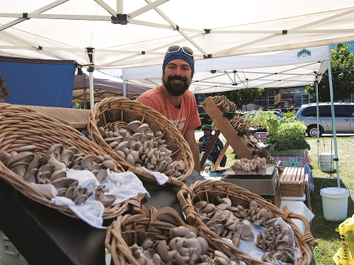 Joaquin Marelli, from Newport, Washington, sells the mushrooms he grows, at the Spokane Farmers' Market. Joaquin was looking forward to running the Kaniksu 50 Ultra at the end of June in under 8 hours. Photo: Amy Silbernagel McCaffree