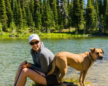 Hiker and her best friend taking a break at Ten Lakes Scenic Area. Photo: Aaron Theisen