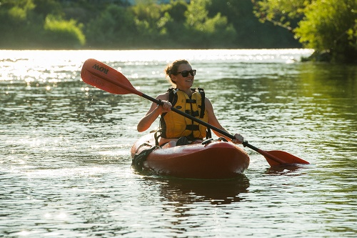 Photo of paddler on the Spokane River by Aaron Theisen.