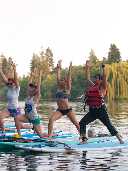 Paddleboard yogis line up in a lunge. Photo: Shallan Knowles