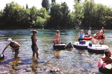 Swimmers cool off in the Spokane River below Sandifur Bridge. Photo: Shallan Knowles