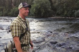 Jerry White calf deep in the Spokane, casting for redbands. Photo: Derrick Knowles