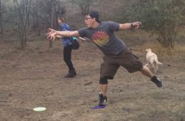 Joe tosses the disk while Kate looks on and Dexter the dog runs for the next hole. Photo: Bea Lackoff