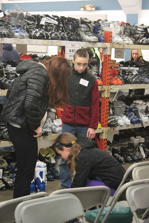 Make sure your kids are there so they can try on the boots and get the right fit. Photo courtesy of Winter Swap