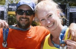 Travis and Liz celebrate at the finish line after 26.2 miles.