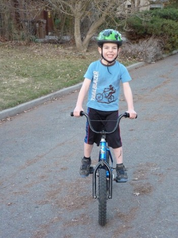 The author's son all smiles on the right bike.