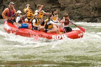 Peter Grubb guiding a boat-load of eager paddlers down the Lower Salmon River. Photo courtesy of ROW Adventures