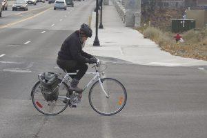 Cyclist crossing Monroe towards Kendall Yards.