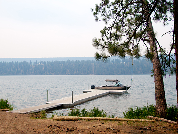 Photo of boat at the end of the dock on Lake Spokane.