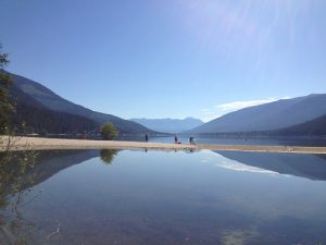 Paddlers heading out on Kootenay Lake near Nelson. Photo: Derrick Knowles
