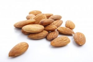 5450335-several-almonds-on-white-background