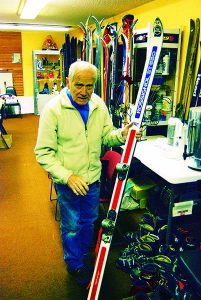 Loulou Kneubuhler showing off one of his collectable skis with an experimental release binding. Photo: Chic Burge