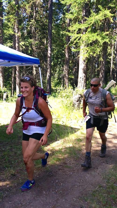 Photo of Erika Prins Simonds running the Kaniksu 50 Ruck Race.