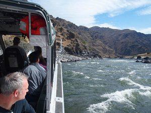 Passengers enjoying an Idaho River jet boat tour.