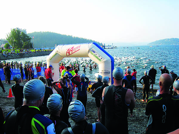 Triathlon swim racers on the beach at Lake Coeur d'Alene ready to start the race.