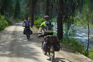 John and Geoff riding to Warm Lake on the first day. // Photo: Hank Greer