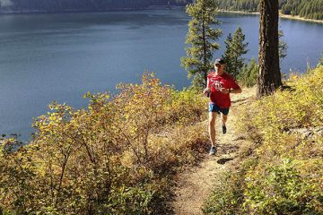 Trail running along Sullivan Lake shoreline by Jon Jonckers.