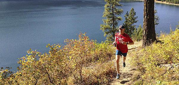 Trail running along Sullivan Lake shoreline by Jon Jonckers.