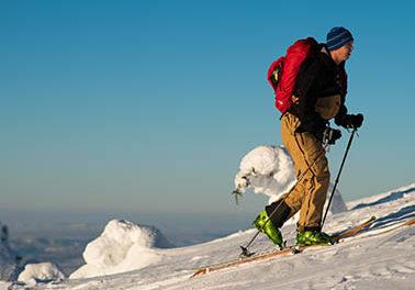 Photo of man skinning uphill.