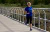 Photo of runner on bridge.