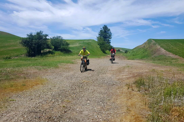 Photo of two bikers on John Wayne Pioneer Trail by Robert Yates