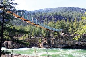 Photo of Kootenai Falls foot bridge by Holly Weiler.