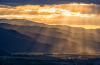 Photo of mountains at sunset by Aaron Theisen