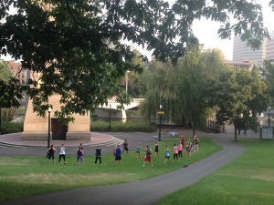Photo of outdoors yoga class in the park by Derrick Knowles.