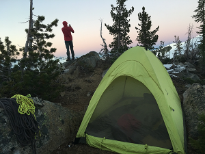 Photo of tent in alpine setting by Summer Hess.
