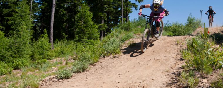 Photo of female mountain bikers courtesy of Silver Mountain Resort.