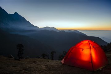 Tent in mountainous landscape.
