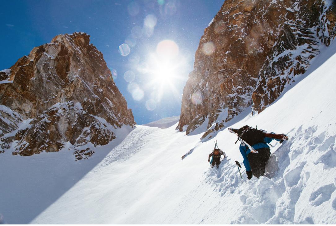 Photo from Winter Wildlands Alliance re: Backcountry Film Festival. Mountaineer skiers approach a steep chute.