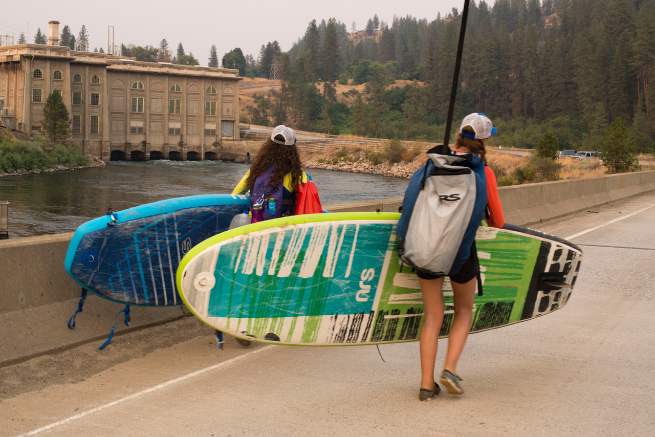 The girls portage their stand up paddle boards (Photo: Jed Conklin Photography)