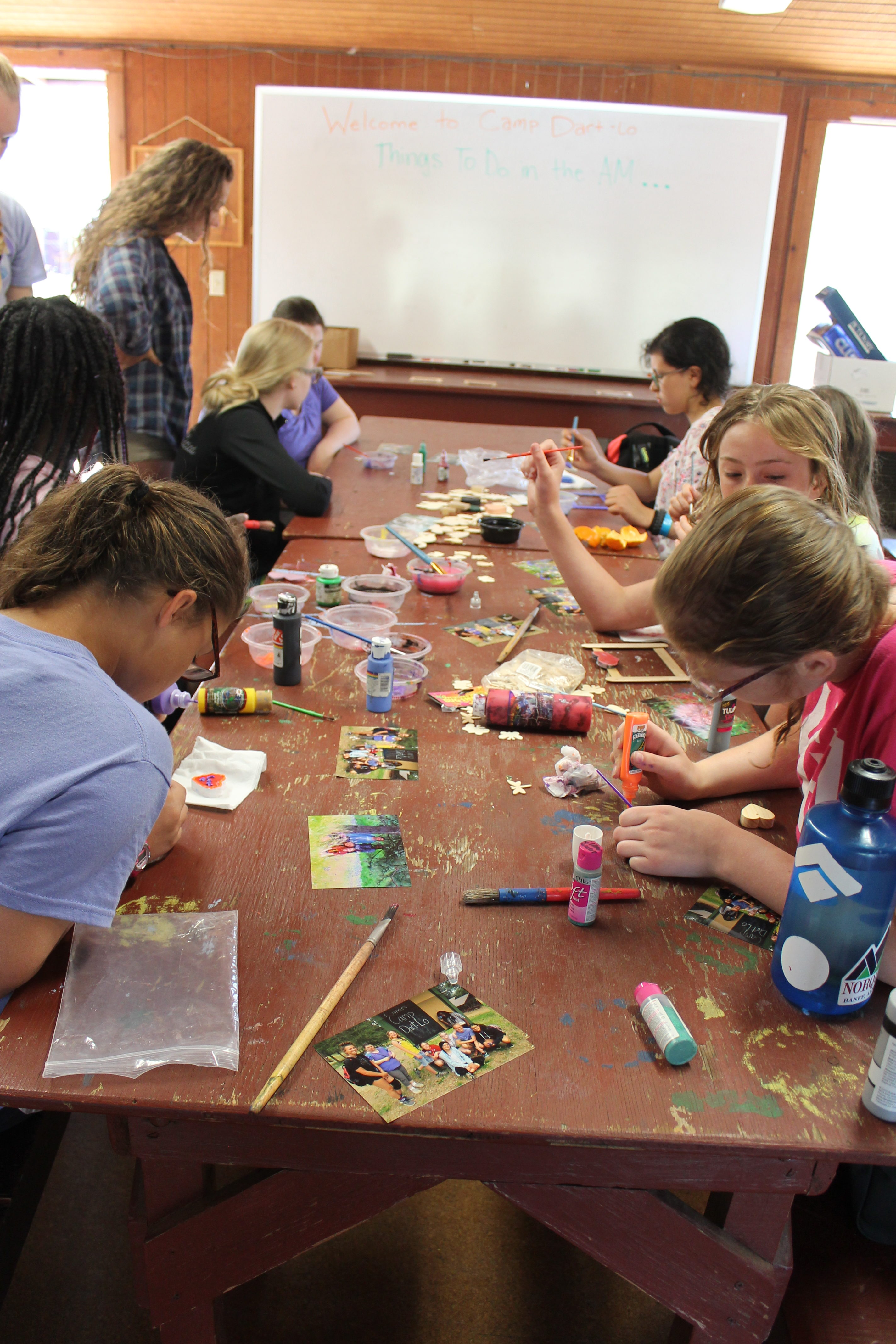 Kids do crafts at a camp table (Photo: Camp Fire Inland Northwest)