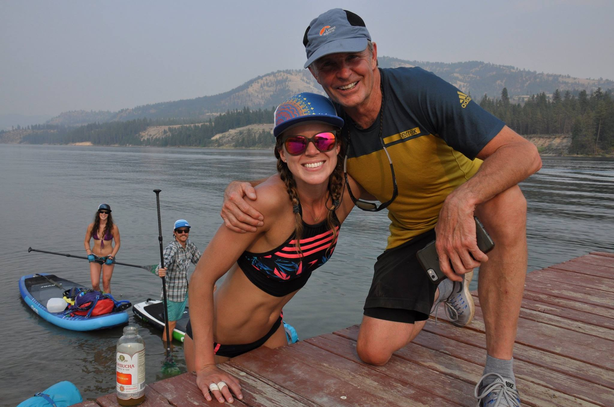 Allie and her father-in-law, John Roskelley, a few hundred yards from the team's final destination at the confluence of the Columbia River and Lake Roosevelt. John and his wife, Joyce, met the team at various stopping points along their route to drop snacks and kombucha. (Photo from Allie Roskelley.)