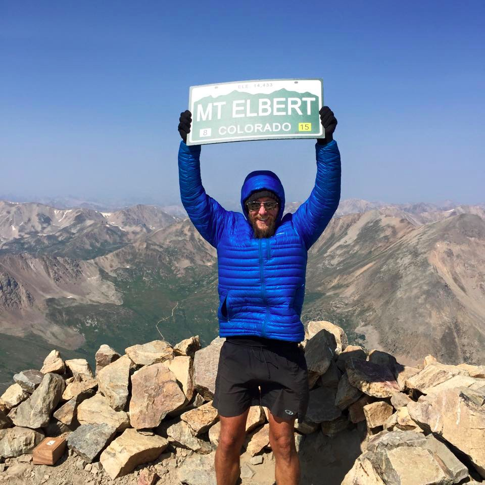 Plaza reaches the top of Mount Elbert, the highest summit in Colorado