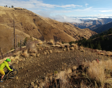 Photo of biker on trail through Hells Canyon.