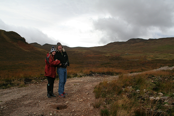 Photo of Anya & Jonathan on a hiking trail in Scotland.