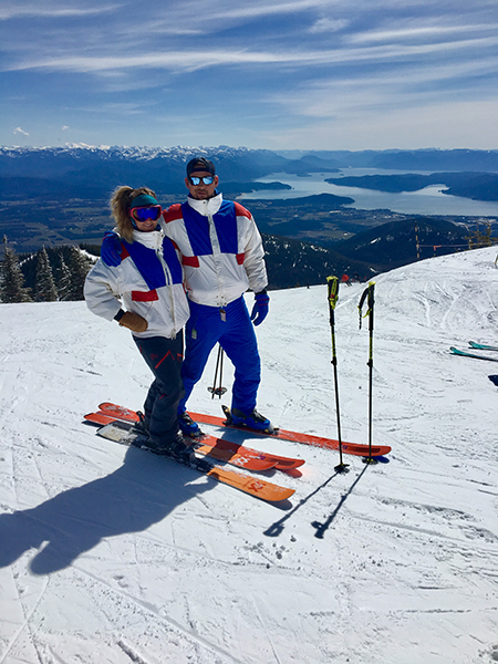 Photo of couple skiing in 90s apparel.