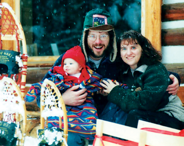 photo of Howko family in front of cabin.