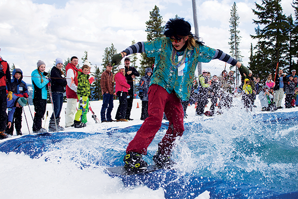 Snowboarder in costume skimming across the pond.